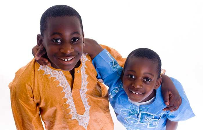 Two boys wearing traditional african dress