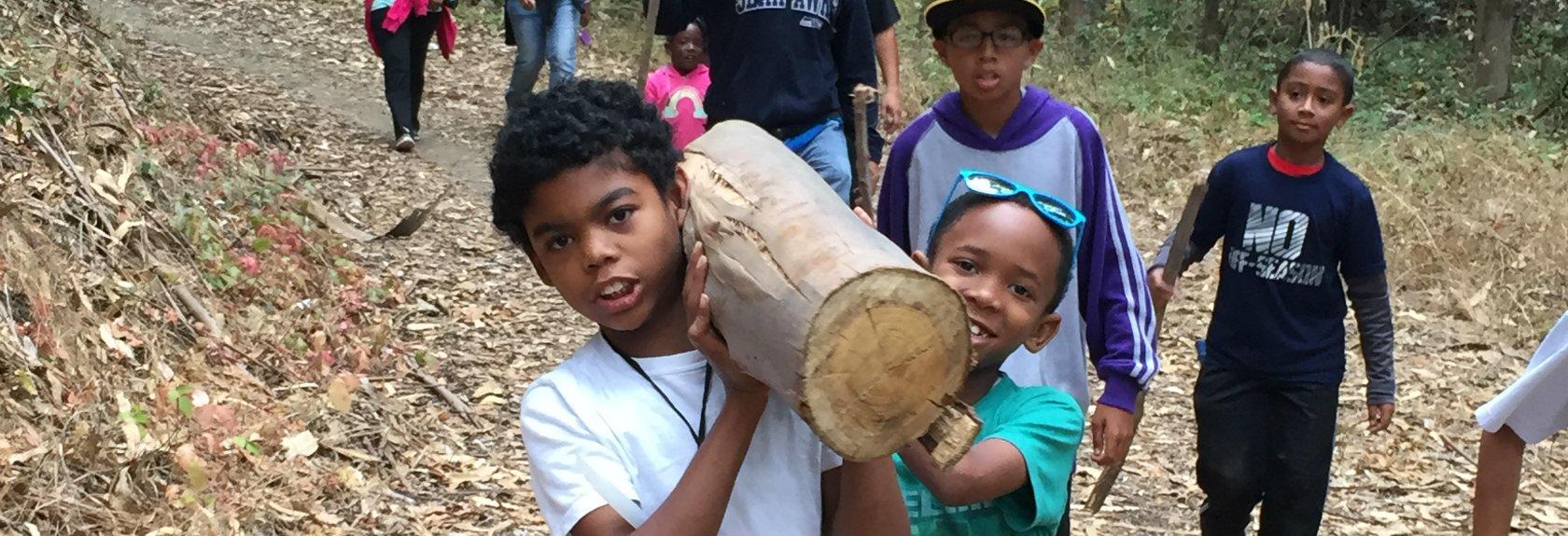 kids carring firewood, the village method