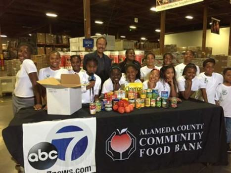 TVM Scholars at Alameda County Food Bank in Oakland with ABC News and Spencer Christian